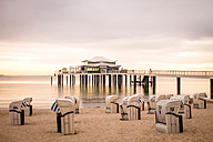 Germany, Niendorf, view to Timmendorfer Strand with hooded beach chairs and sea bridge - PUF000407
