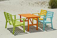 Corsica, Calvi, colorful tables and benches at beach - LBF001154