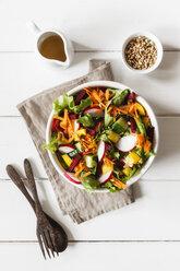 Mixed salad in bowl on wood - EVGF002017