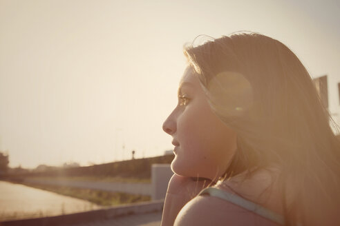 Pensive teenage girl at backlight - MMFF000975