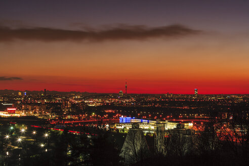 Germany, Bavaria, Munich, Cityscape at sunset with Alps in background - PEDF000066