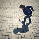 Young toddler boy sweeping the backyard floor - ABAF001852