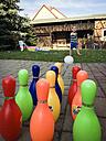 Toddler boy at outdoor backyard bowling - ABA001858