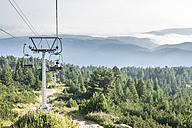 Bulgaria, Rila Mountains, senior woman using chairlift - DEGF000493