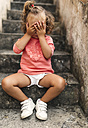 Little girl covering face with her hands - MGOF000408