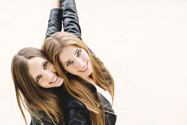 Two female friends wearing black leather jackets - GEMF000300