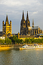 Germany, Cologne, View to Great St Martin, Cologne dome, Old town riverside, Rhine river in the evening - WGF000693