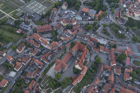 Germany, aerial view of Quedlinburg with collegiate church in the evening - PVCF000535