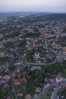Germany, aerial view of Gernrode with collegiate church St. Cyriakus in the evening - PVCF000572