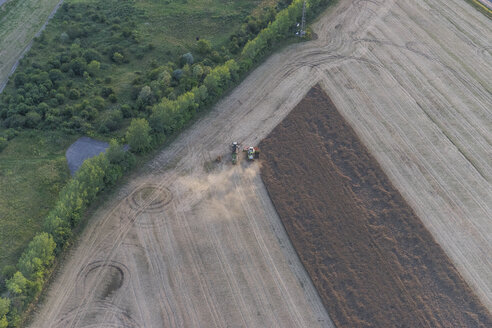 Germany, aerial view of combine harvester at work on a field - PVCF000578