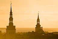 Estonia, Tallinn, Church spires at sunset - FCF000737