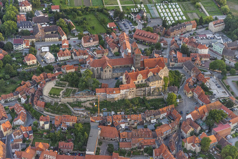 Germany, aerial view of Quedlinburg with collegiate church in the evening - PVCF000589