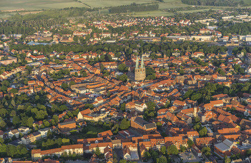 Germany, aerial view of Quedlinburg with St Nicholas' Church at evening twilight - PVCF000598