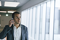 Portrait of businessman talking on his phone - BZF000183
