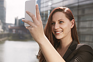 Young woman taking a selfie outdoors - STKF001410
