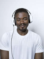 Portrait of smiling young man with headphones - STKF001428