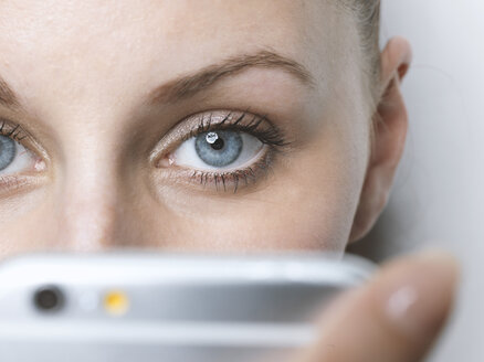 Close-up of woman with cell phone - STKF001431