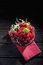 Bowl of red currants on cloth and dark wood - CSF026122