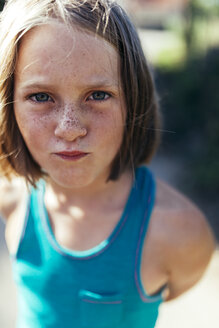 Portrait of girl with brown hair and freckles - MGOF000431