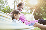Relaxed mother and daughter in hammock - RBF003452