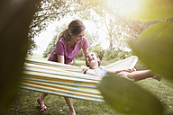 Relaxed mother and daughter in hammock - RBF003455