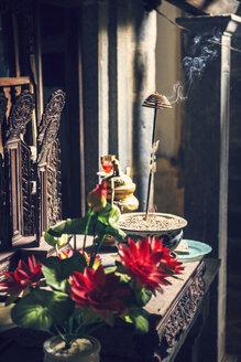 Vietnam, Hanoi, incense burning in buddhist altar - EHF000113