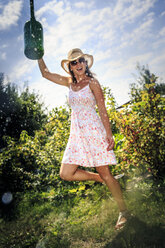 Young woman working in the garden, watering can - VTF000438