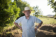 Portrait of farmer with hands on his hips - RAEF000312