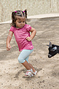 Little girl running away from a goat - ERLF000010
