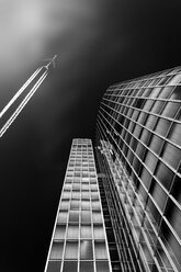 Germany, Duesseldorf, office tower and flying jet seen from below - DWI000572