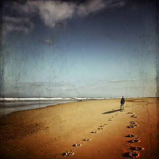 France, Contis-Plage, man walking on the beach looking to the sea - DWI000580