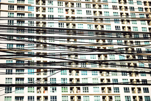 Thailand, Bangkok, tangled and messy electrical cables in front of a facade - EH000158