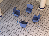 Four blue armchairs standing in circle on tiled floor - UWF000593