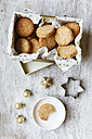 Box of whole grain cocos cookies, Christmas decoration and cookie cutter on wood - EVGF002081