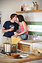 Young couple kissing in the kitchen - TOYF001105