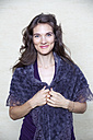 Portrait of happy woman with purple shawl - NDF000550