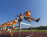 Multiple image of female hurdler jumping over hurdle - STSF000856
