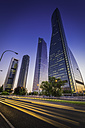 Spain, Madrid, Cuatro Torres, highway traffic zooming past futuristic skyscrapers - FV000009