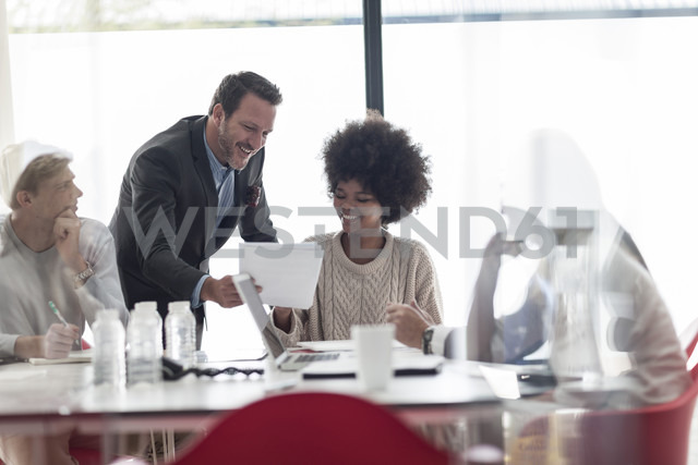 Confident businesspeople with documents in conference room - ZEF007447 - zerocreatives/Westend61