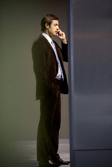 Confident businessman on the phone - TOYF001247