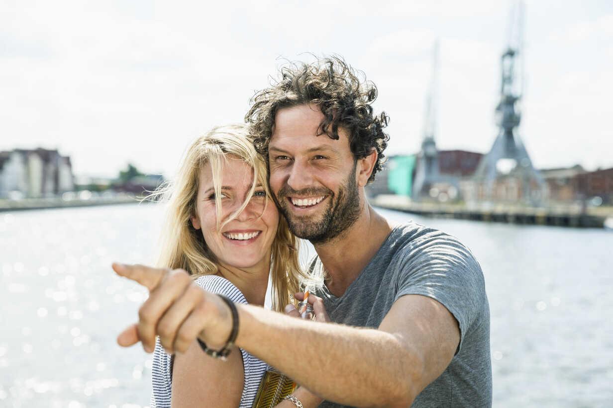 Germany, Luebeck, smiling couple at the harbor - FMKF001852 - Jo Kirchherr/Westend61