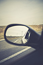 Germany, Brandenburg, reflection  of wind turbines in wing mirror on a country road - ASCF000329