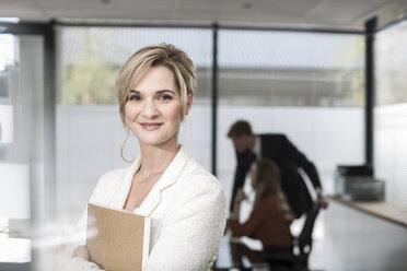 Portrait of smiling businesswoman in office - ZEF007158