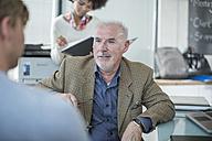 Colleagues talking in office - ZEF007180