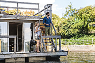 Couple having a trip on a house boat - FMKF001919
