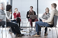 Colleagues in office having an informal meeting - ZEF007205