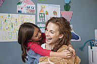 Mother and little daughter having fun together in children's room - RBF003378