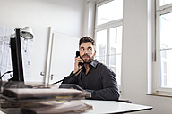 Man at desk in office on the phone - PESF000085