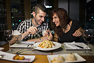 Young couple in modern restaurant having dinner - JASF000003