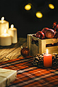 Christmas decoration with burning candles and checkered blanket - AKNF000021